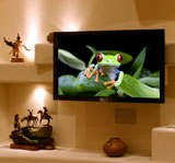 Large screen plasma or LCD television in a custom home entertainment center design