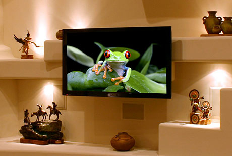 Large screen plasma or lcd tv designed into a custom home media wall