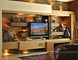 Contemporary custom home entertainment center design featuring a large screen plasma or LCD TV display