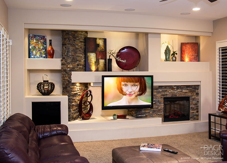 Modern, contemporary design custom home media wall with floating LCD TV, custom natural stone accents, stone fireplace, art niches, and custom lighting design. Custom design-build by DAGR Design