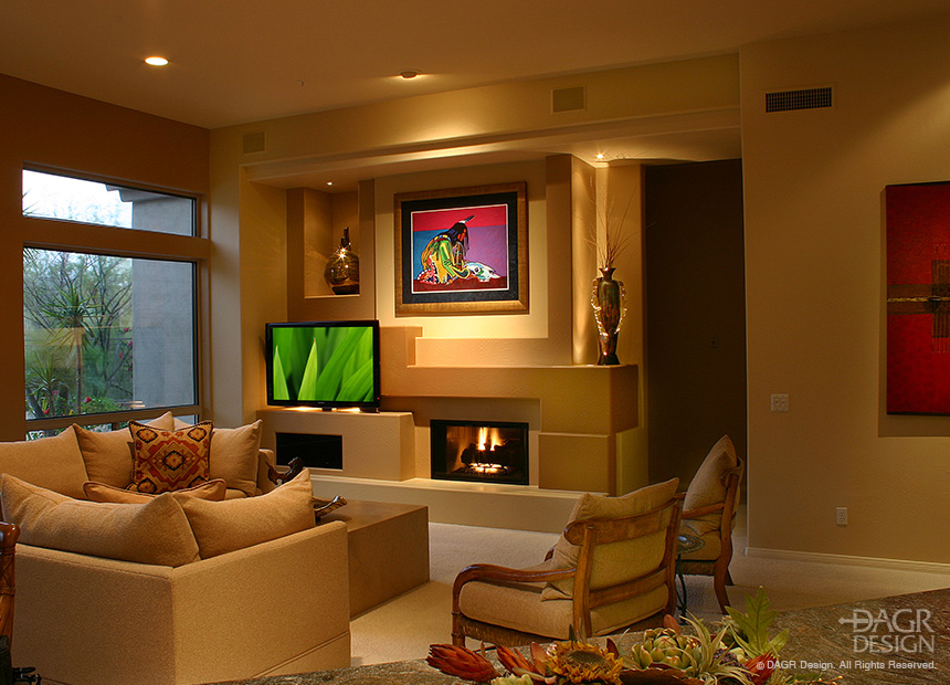 Custom home entertainment center design incorporating LCD TV, fireplace, and custom artwork niches by DAGR Design