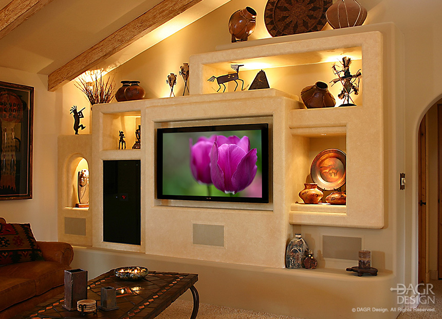 Contemporary Southwest style custom media wall home entertainment center with multiple niches and custom lighting for collectibles. Design and custom-build by DAGR Design