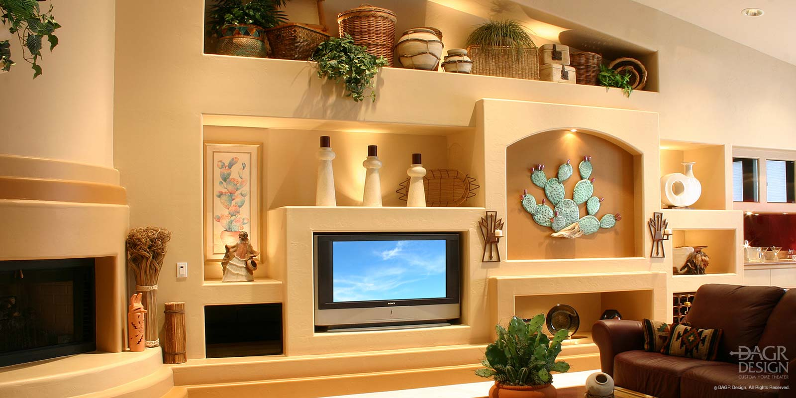 Southwest style custom media wall design with fireplace, decorative lighted niches, plant shelf, and inset LCD tv custom designed and installed by DAGR Design