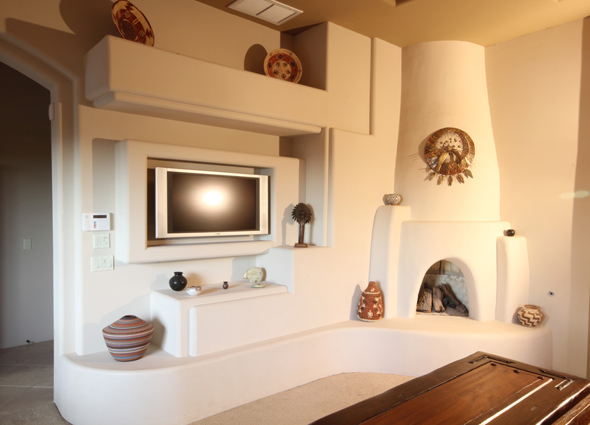 Southwest Style Custom Media Wall Design with Kiva Fireplace