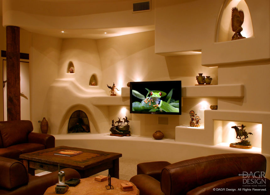 Modern kiva style beehive fireplace in a drywall Southwest style custom media wall design by DAGR Design.