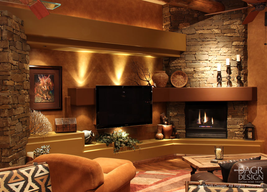 Natural stone custom media wall in a lodge style living room custom designed by DAGR Design