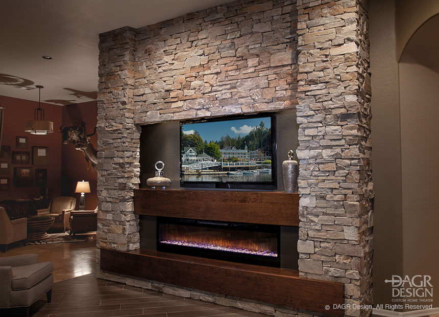 Stacked stone minimalist style media wall with bold columns and LCD tv floated above a fireplace custom designed by DAGR Design