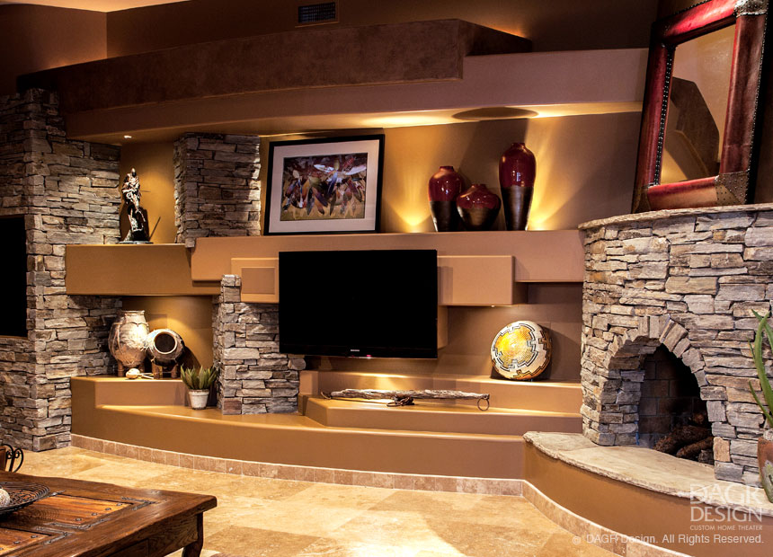 Stone media wall design with kiva style corner fireplace custom designed by DAGR Design