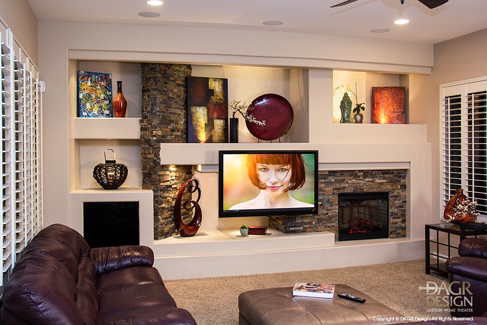 Photo of finished custom drywall home entertainment media center created by DAGR Design for pro football player Paris Lenon
