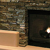 Natural Stone Accents On A Custom Media Wall